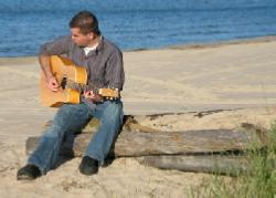 Kevin Bulmer playing guitar